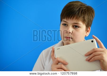 Portrait of teenage boy with tablet computer in hands