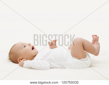 Baby In White Onesie Lying Down On Back, Happy Toddler In Bodysuit