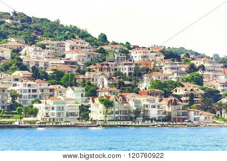 Modern buildings and beach with Cliffs in Kas village, Turkey