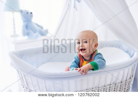 Cute Baby In White Nursery