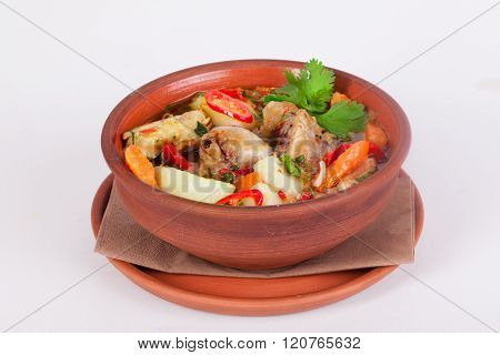 national food roast with potatoes and chicken turkey bird foot game with green onion carrot tomato