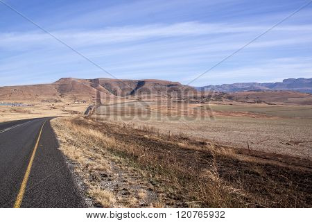Asphalt Road Stretching Through Arid Dry Winter Landscape