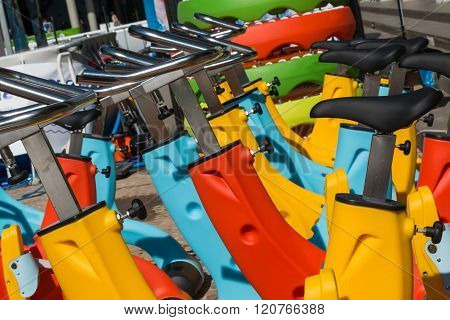 Colorful Aquatic Bikes In Line, Designated For Swimming Pool