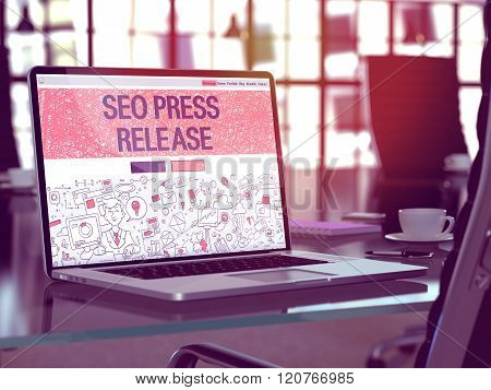 Seo Press Release on Laptop in Modern Workplace Background.
