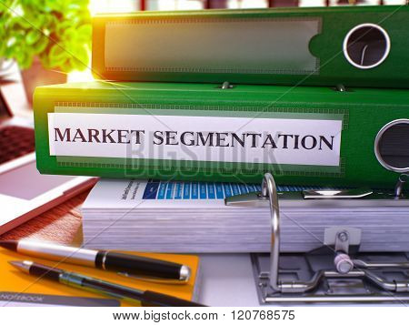 Market Segmentation on Green Office Folder. Toned Image.