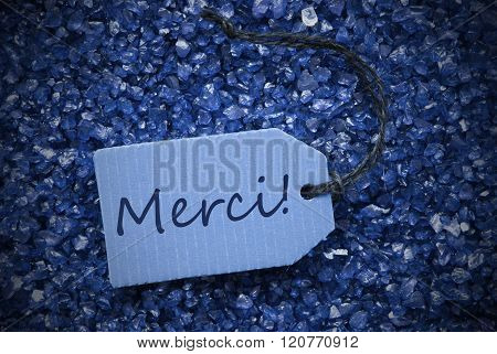 Purple Stones With Label Merci Means Thank You