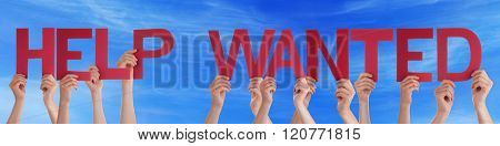 People Hands Holding Red Straight Word Help Wanted Blue Sky