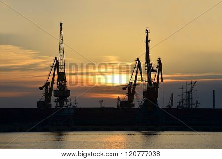 Port Cargo Crane At Sunset