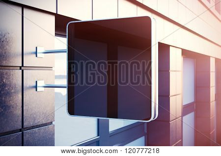 Black cristal digital screen on the bulding city. Concrete facades of modern buildings in background