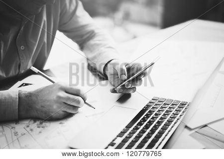 Businessman in modern office. Texting message smartphone and holding pencil hands. Generic design no