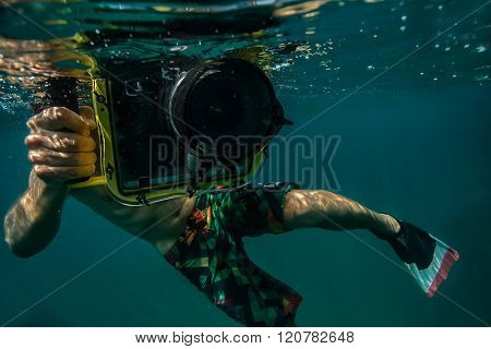 Diver taking underwater photo.