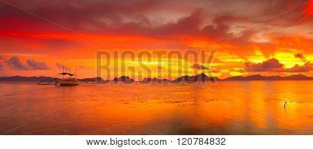 Traditional philippine boats bangka at sunset time. Panorama