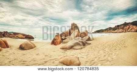 Beautiful beach panorama. Stones on the foreground