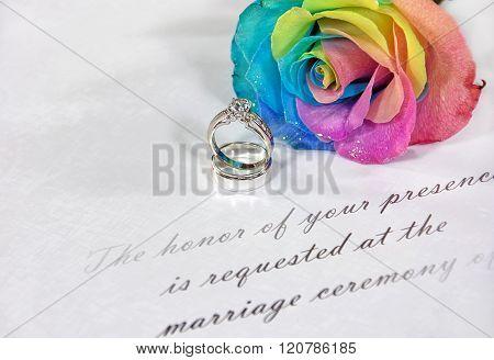 rainbow rose on wedding invitation