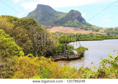 GRAND PORT, MAURITIUS ISLAND - 1. NOVEMBER, 2015: Monument to Dutch landing in 1598 year. This amazing view to bay with mangroves is main touristic attraction. Nature and history on Mauritius.
