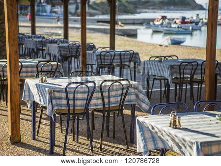 Greek tavern with blue chairs, Greece