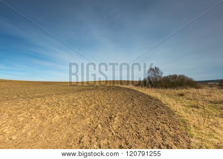 Early Springtime Plowed Field Landscape