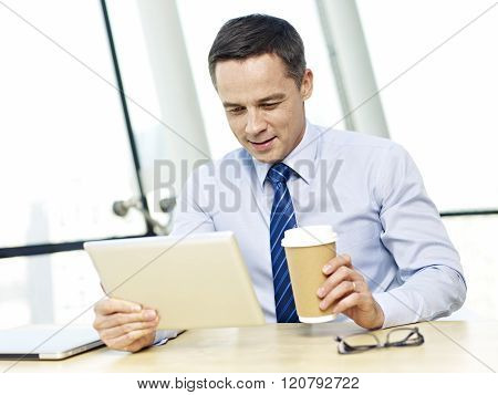 Business Person Using Tablet In Office