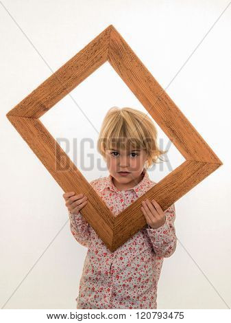 child looking through a frame