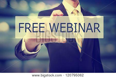 Business Man Holding Free Webinar