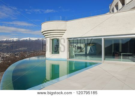 Architecture, beautiful penthouse with infinity pool, exterior
