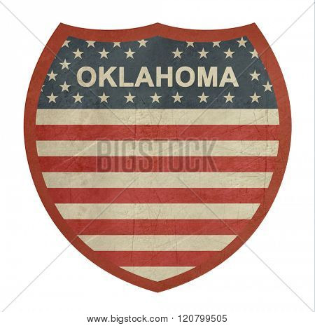 Grunge Oklahoma American interstate highway sign isolated on a white background.