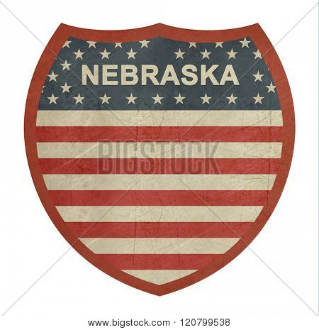 Grunge Nebraska American interstate highway sign isolated on a white background.