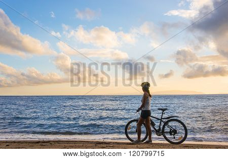 Young Woman With Bicycle At The Beach