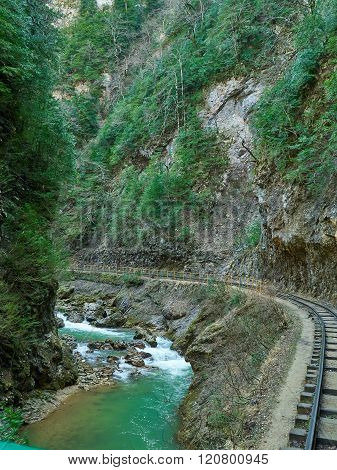 Mountain Stream And Railroad In Springtime.