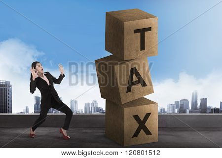 Asian Business Woman Shock Looking Tax Block