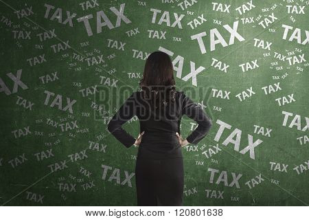 Asian Business Person Thinking Hard About Tax