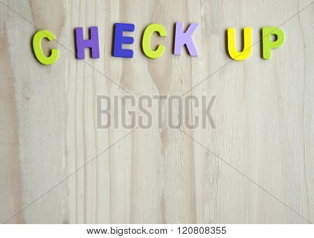 Check Up Colorful Text With Copy Space On Wood Table Background
