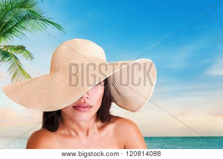 Young Woman In Hat On The Beach