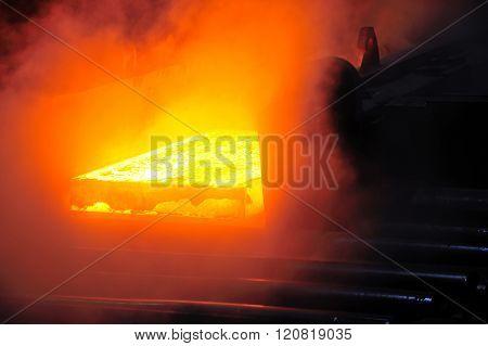 hot steel plate on conveyor in steel mill