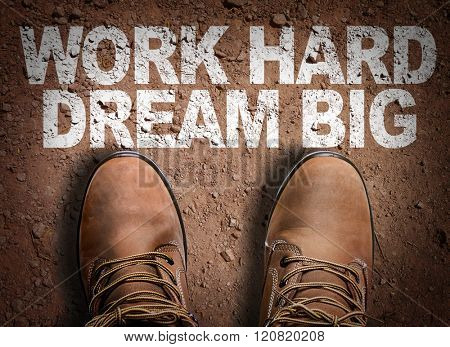 Top View of Boot on the trail with the text: Work Hard Dream Big