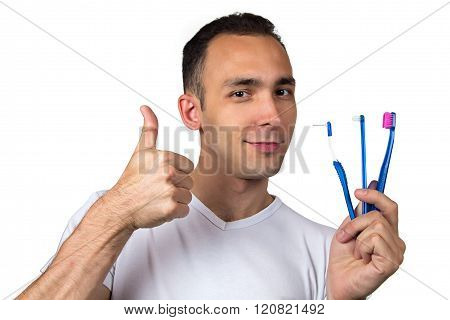 Smiling man with toothbrushes