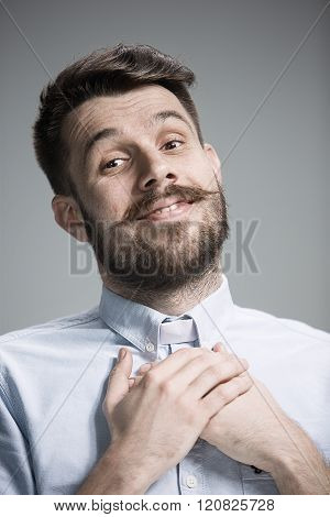 Man is looking imploring over gray background