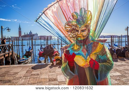 Amazing Carnival Mask Against Gondolas In Venice, Italy