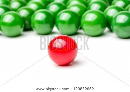 Concept With Red And Green Marbles -  Leader