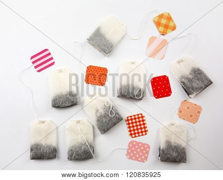 Unused teabags with colourful labels isolated on white background
