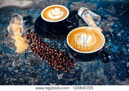 Two Cups Of Coffee With Latte Art. Barista Pouring Coffee