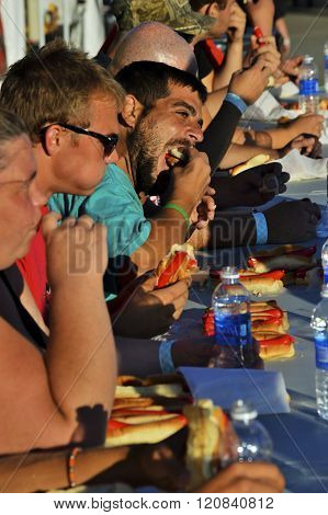 Bangor, Maine/USA-August 6: A hot dog eating contest at the Bangor State Fair on August 6, 2014 displays the fun gluttony that usually takes place.