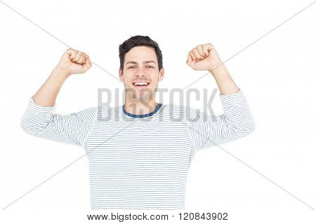 Triumphant man raising fist on white background