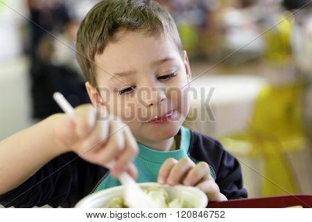 Kid Eating Pelmeni