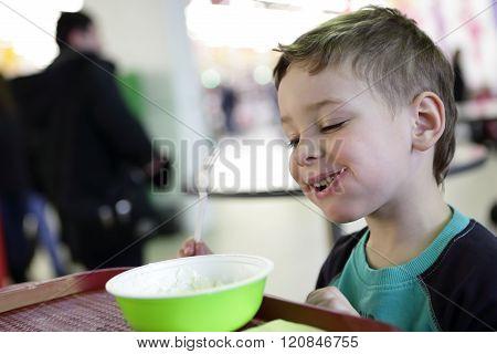 Smiling Kid Eating Meat Dumplings