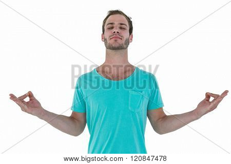 Portrait of a hipster man mediating on white background