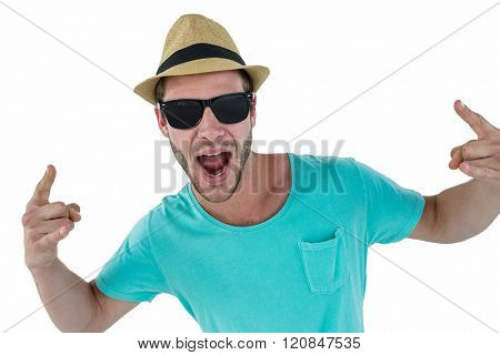 Hipster showing rock and roll hand sign on white background
