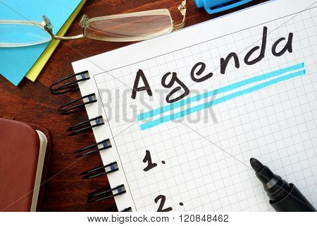 Agenda written in a notebook.