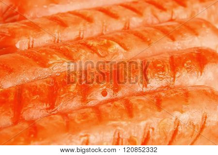 served beef red sausages over white background