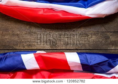 France And Britain Flag On A Wooden Background